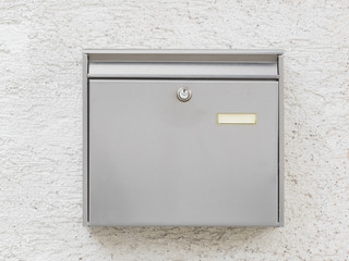 A silver mailbox on the wall