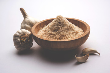 Garlic powder is ground, dehydrated garlic. It's a common seasoning  for pasta, pizza and grilled chicken.