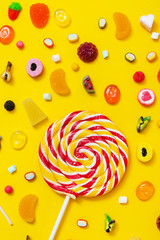 colorful candy on the yellow background