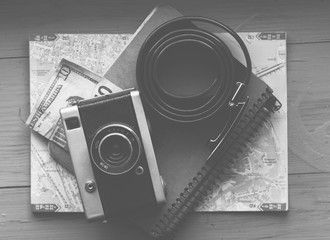 old camera and travel map, the concept of a tourist's life. Plan a trip.