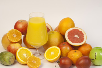 Exotic fruits and juice on a white background