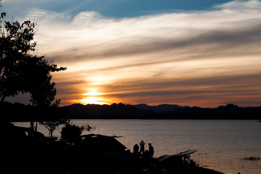 Sunset sky in campsite near the lake, Twilight sky, Travel and Camping concept