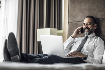 Businessman at Hotel Room
