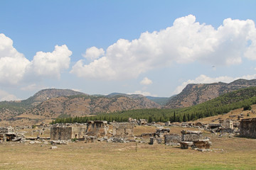 The ruins of the ancient Hierapolis city next to the travertine pools of Pamukkale, Turkey.