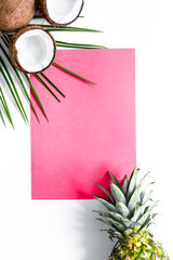 Concept of summer tropical fruits. Pineapple, cocount and palm b