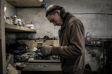 Mechanic working at workshop bench