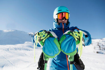 Portrait of skier in snow, front view