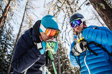 Two skiers standing together, outdoors, low angle view