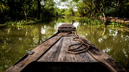 boat on the canal of the Mekong Delta in Asia