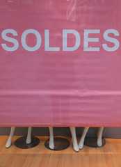 """A banner announces """"Sales"""" on a clothing store front window during the start of winter sales in Strasbourg"""