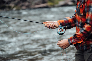 Cropped view of man fishing