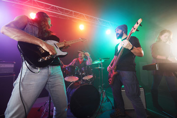 Guitarist and bass player perform on stage.
