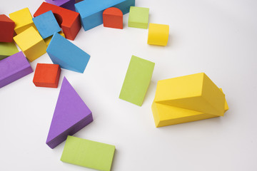 Baby multi-colored building blocks on a white background