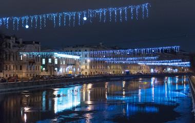 View on the Fontanka river at night from Anichkov bridge.