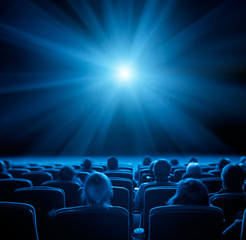 viewers in cinema, blue toning