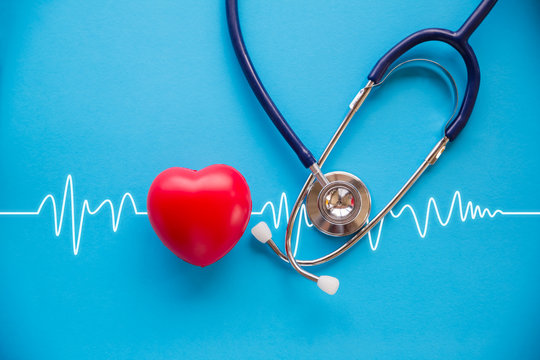 stethoscope and red heart with cardiogram