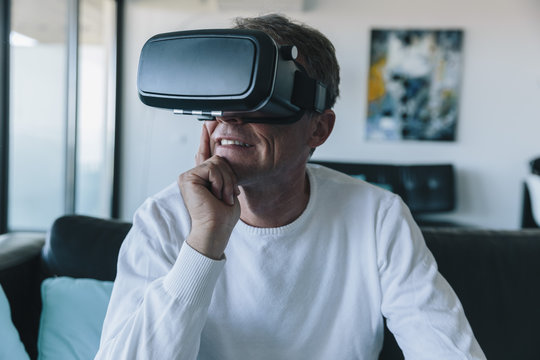 Man wearing VR glasses in an apartment