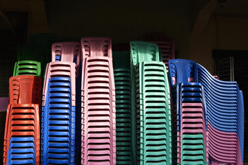 Stacks of coloured plastic chairs