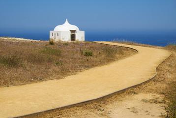 Path near Ermida da Memoria or Memory Chapel of Nossa Senhora do Cabo Church near cape Espichel, Portugal