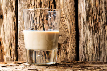 cream liqueur in a glass wooden table