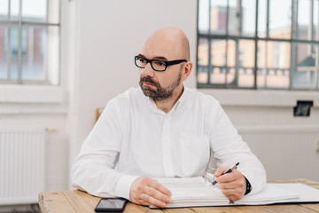 Man with worried facial expression at desk