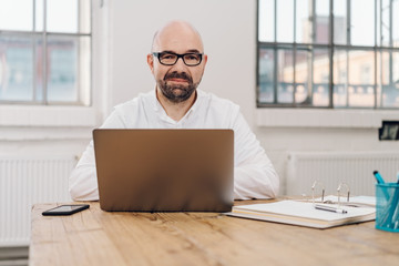 Businessman looking pensively at the camera