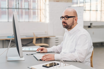 Man working with concentration on desktop computer