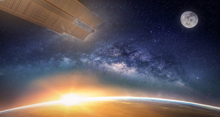 Wall Mural - Landscape with Milky way galaxy. Sunrise, Earth, moon and satellite view from space with Milky way galaxy. (Elements of this image furnished by NASA)