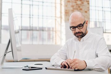 Designer working with a digital tablet and pen