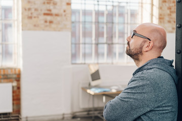 Middle-aged man daydreaming about future projects