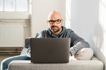 Man working at home on a laptop