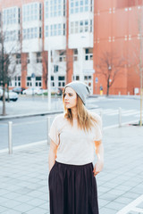Young beautiful woman posing outdoor in the city - getting away from it all, city living, everyday life concept