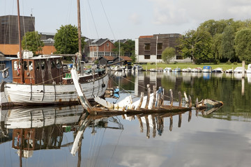 House Boat with a Boat Wreck in Copenhagen Channel