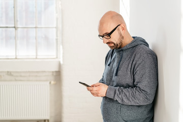 Side view of middle-aged man using a mobile phone