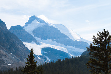 Mountains with glacier in Rocky Mountains, Alberta on sunny day