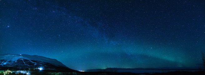 Winter panorama with Milky way and Northen lights in Keruna.