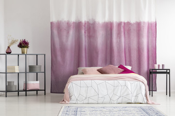 Bedroom with dyed curtain