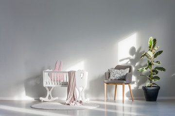 White cradle with pink blanket