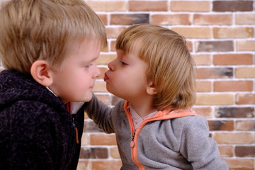 Happy kids. Little cute sister kissing brother