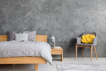Grey bedroom with armchair