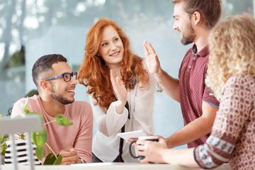 Cooperation between busineswoman and employee