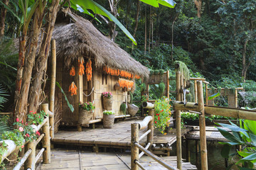 Wooden bamboo house in forest.
