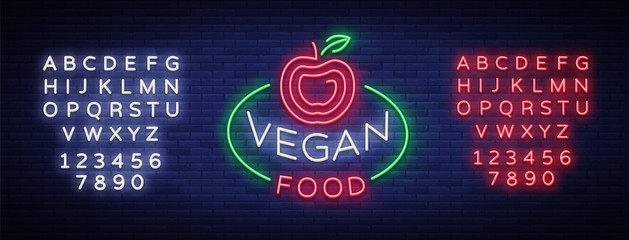 Vegan logo Neon sign, vegan symbol, bright luminous sign, neon night advertising on the theme Vegetarian food, healthy organical food, vegetables, fruits. Vector illustration. Editing text neon sign