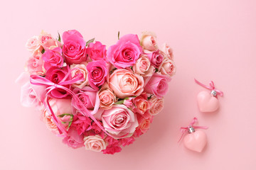 Valentines heart shaped bouquet of beautiful pink rose flowers with heart ornaments