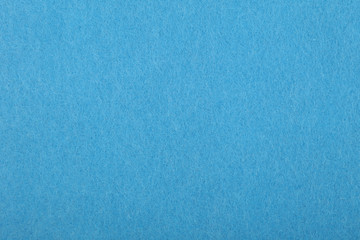 Blue felt background texture close up