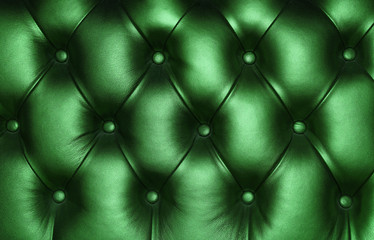 Dark green leather capitone background texture