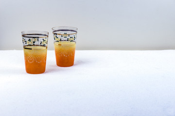A pair hand crafted yellow orange vintage drinking glasses