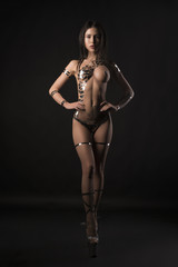 Nude girl her body covered with gold tape