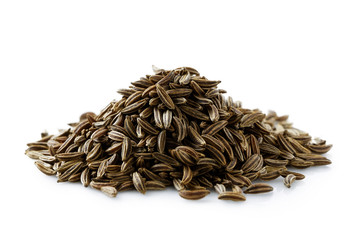 A pile of dry caraway or cumin seeds isolated on white.