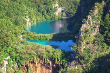 Plitvice Lakes National Park, view from popular viewpoint, amazing emerald color lakes and waterfalls surrounded by green forests, daytime summer landscape, famous tourist destination in Croatia